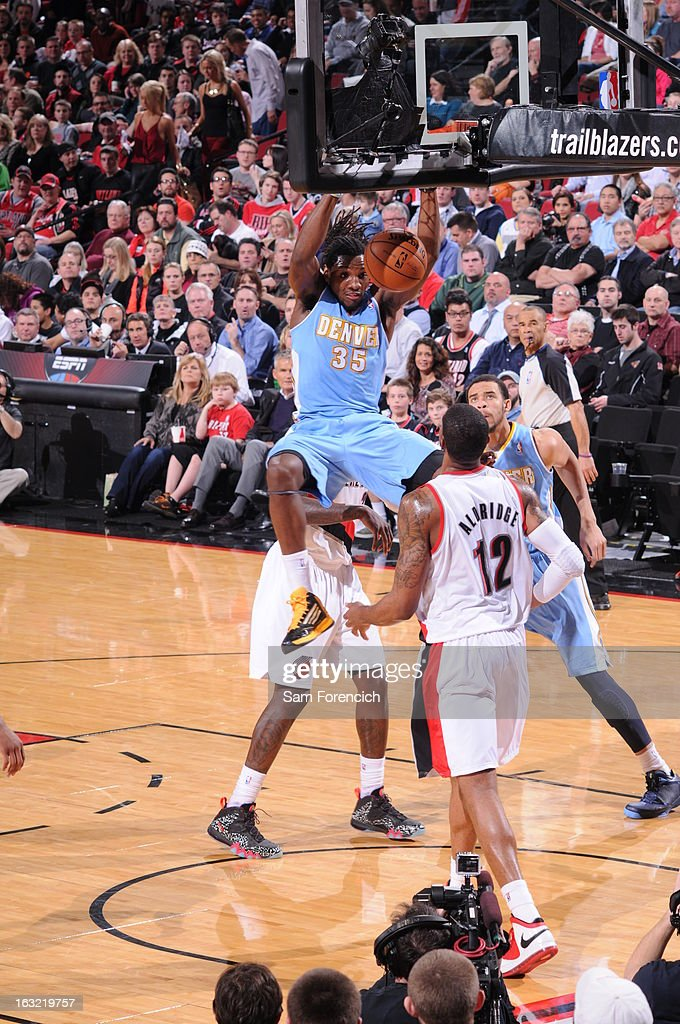 <a gi-track='captionPersonalityLinkClicked' href=/galleries/search?phrase=Kenneth+Faried&family=editorial&specificpeople=5765135 ng-click='$event.stopPropagation()'>Kenneth Faried</a> #35 of the Denver Nuggets dunks the ball against the Portland Trail Blazers on February 27, 2013 at the Rose Garden Arena in Portland, Oregon.