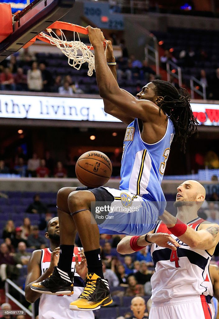 <a gi-track='captionPersonalityLinkClicked' href=/galleries/search?phrase=Kenneth+Faried&family=editorial&specificpeople=5765135 ng-click='$event.stopPropagation()'>Kenneth Faried</a> #35 of the Denver Nuggets dunks the ball in front of <a gi-track='captionPersonalityLinkClicked' href=/galleries/search?phrase=Marcin+Gortat&family=editorial&specificpeople=589986 ng-click='$event.stopPropagation()'>Marcin Gortat</a> #4 of the Washington Wizards for the go head score during the Nuggets a 75-74 win at Verizon Center on December 9, 2013 in Washington, DC.