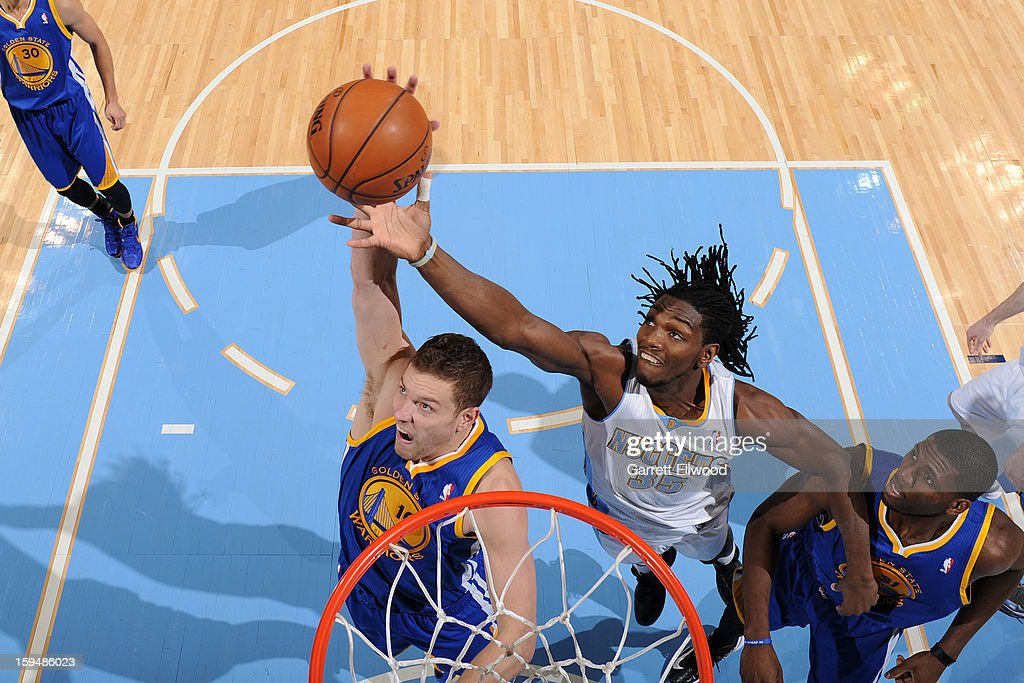 Kenneth Faried #35 of the Denver Nuggets fights for the rebound against David Lee #10 of the Golden State Warriors on January 13, 2013 at the Pepsi Center in Denver, Colorado.