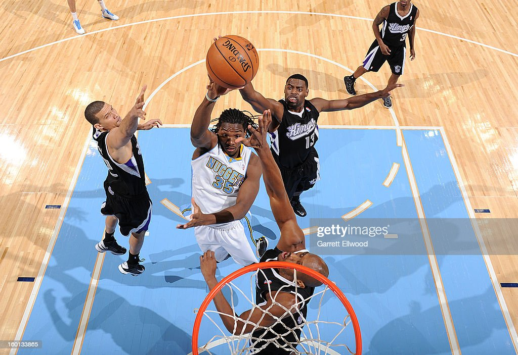 <a gi-track='captionPersonalityLinkClicked' href=/galleries/search?phrase=Kenneth+Faried&family=editorial&specificpeople=5765135 ng-click='$event.stopPropagation()'>Kenneth Faried</a> #35 of the Denver Nuggets goes to the basket against <a gi-track='captionPersonalityLinkClicked' href=/galleries/search?phrase=Tyreke+Evans&family=editorial&specificpeople=4851025 ng-click='$event.stopPropagation()'>Tyreke Evans</a> #13 of the Sacramento Kings during the game between the Sacramento Kings and the Denver Nuggets on January 26, 2013 at the Pepsi Center in Denver, Colorado.
