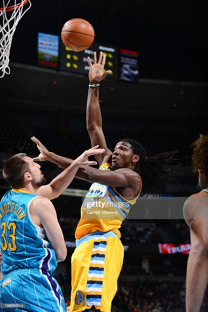 Kenneth Faried #35 of the Denver Nuggets goes to the basket against Ryan Anderson #33 of the New Orleans Hornets during the game between the New Orleans Hornets and the Denver Nuggets on November 25, 2012 at the Pepsi Center in Denver, Colorado.