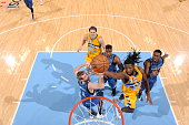 Kenneth Faried of the Denver Nuggets goes to the basket against the Minnesota Timberwolves on December 26 2014 at the Pepsi Center in Denver Colorado...