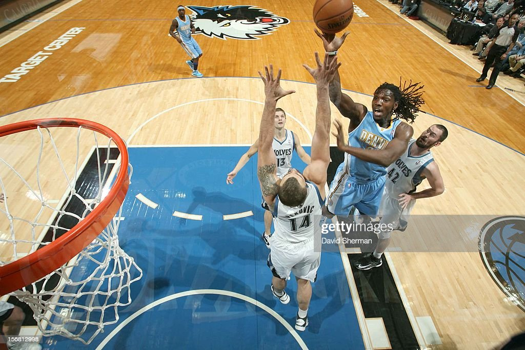 Kenneth Faried #35 of the Denver Nuggets goes to the basket during the game between the Minnesota Timberwolves and the Denver Nuggets on November 21, 2012 at Target Center in Minneapolis, Minnesota.