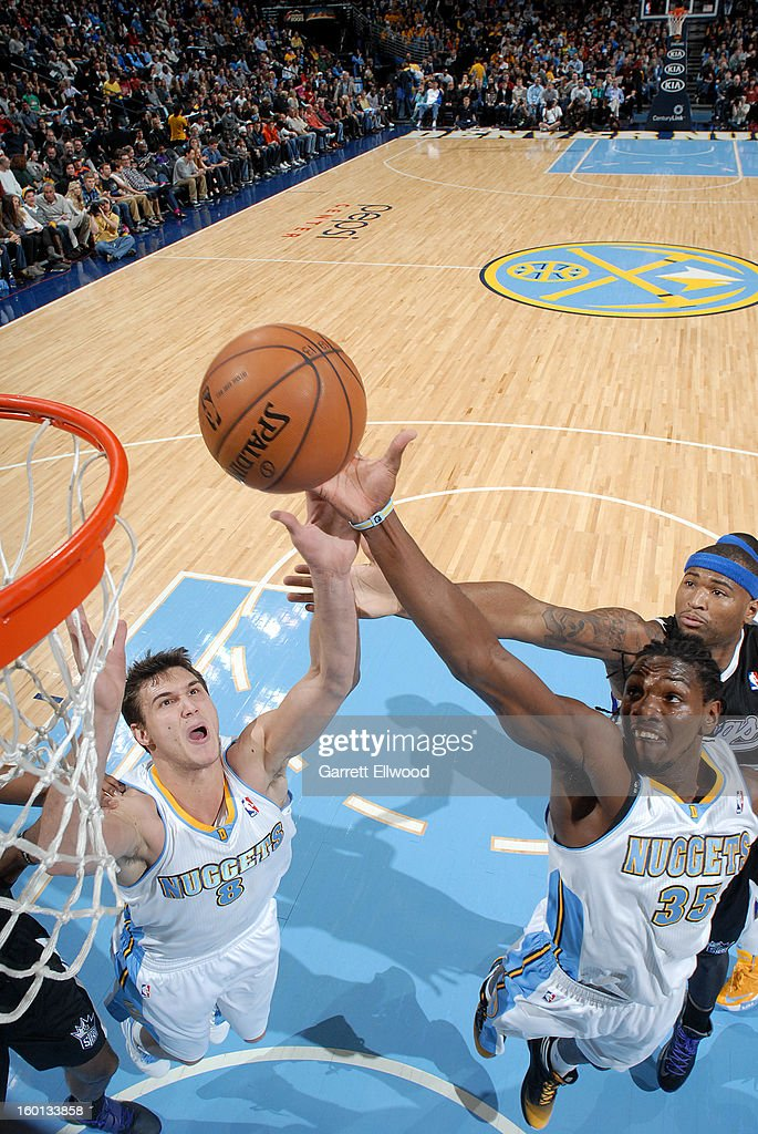 <a gi-track='captionPersonalityLinkClicked' href=/galleries/search?phrase=Kenneth+Faried&family=editorial&specificpeople=5765135 ng-click='$event.stopPropagation()'>Kenneth Faried</a> #35 of the Denver Nuggets goes to the basket with assistance from Danilo Gallinari #8 of the Denver Nuggets during the game between the Sacramento Kings and the Denver Nuggets on January 26, 2013 at the Pepsi Center in Denver, Colorado.