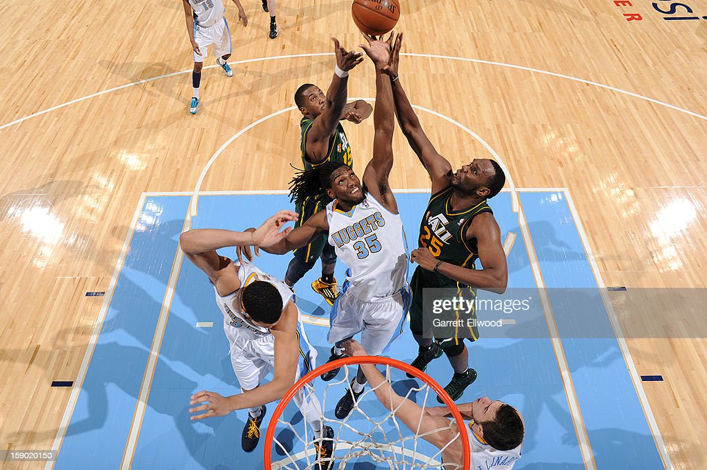 Kenneth Faried #35 of the Denver Nuggets goes up for a rebound against Al Jefferson #25 of the Utah Jazz on January 5, 2013 at the Pepsi Center in Denver, Colorado.