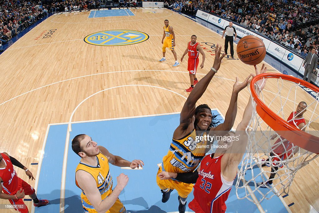 <a gi-track='captionPersonalityLinkClicked' href=/galleries/search?phrase=Kenneth+Faried&family=editorial&specificpeople=5765135 ng-click='$event.stopPropagation()'>Kenneth Faried</a> #35 of the Denver Nuggets goes up for a rebound against <a gi-track='captionPersonalityLinkClicked' href=/galleries/search?phrase=Blake+Griffin+-+Basketball+Player&family=editorial&specificpeople=4216010 ng-click='$event.stopPropagation()'>Blake Griffin</a> #32 of the Los Angeles Clippers on January 1, 2013 at the Pepsi Center in Denver, Colorado.