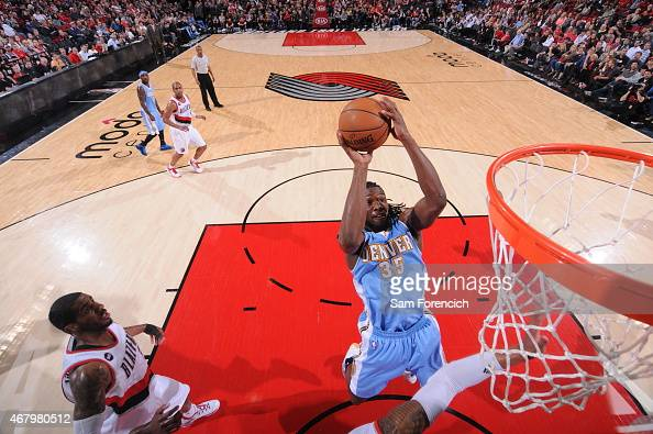 Kenneth Faried of the Denver Nuggets goes up for a shot against the Portland Trail Blazers on March 28 2015 at the Moda Center Arena in Portland...