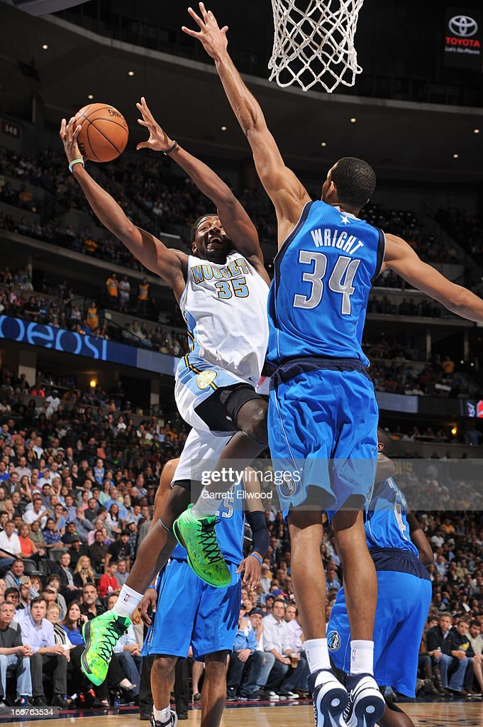 Kenneth Faried #34 of the Denver Nuggets goes up strong against Brandan Wright #34 of the Dallas Mavericks on April 4, 2013 at the Pepsi Center in Denver, Colorado.