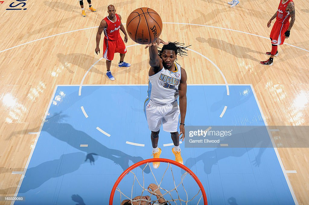<a gi-track='captionPersonalityLinkClicked' href=/galleries/search?phrase=Kenneth+Faried&family=editorial&specificpeople=5765135 ng-click='$event.stopPropagation()'>Kenneth Faried</a> #35 of the Denver Nuggets goes up strong to the basket versus the Los Angeles Clippers on March 7, 2013 at the Pepsi Center in Denver, Colorado.
