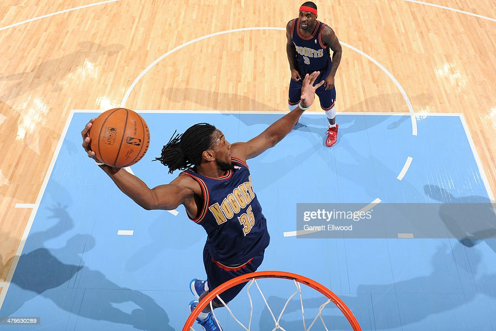 <a gi-track='captionPersonalityLinkClicked' href=/galleries/search?phrase=Kenneth+Faried&family=editorial&specificpeople=5765135 ng-click='$event.stopPropagation()'>Kenneth Faried</a> #35 of the Denver Nuggets grabs a rebound against the Los Angeles Clippers on March 17, 2014 at the Pepsi Center in Denver, Colorado.