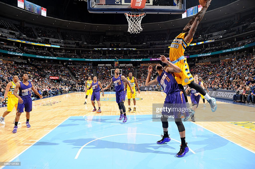 <a gi-track='captionPersonalityLinkClicked' href=/galleries/search?phrase=Kenneth+Faried&family=editorial&specificpeople=5765135 ng-click='$event.stopPropagation()'>Kenneth Faried</a> #35 of the Denver Nuggets grabs a rebound against the Denver Nuggets on December 20, 2013 at the Pepsi Center in Denver, Colorado.