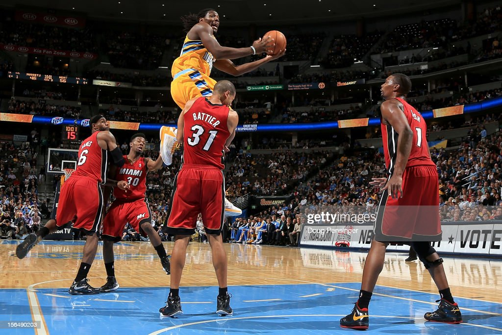 <a gi-track='captionPersonalityLinkClicked' href=/galleries/search?phrase=Kenneth+Faried&family=editorial&specificpeople=5765135 ng-click='$event.stopPropagation()'>Kenneth Faried</a> #35 of the Denver Nuggets is charged with an offensive foul as he collides with <a gi-track='captionPersonalityLinkClicked' href=/galleries/search?phrase=Shane+Battier&family=editorial&specificpeople=201814 ng-click='$event.stopPropagation()'>Shane Battier</a> #31 of the Miami Heat at the Pepsi Center on November 15, 2012 in Denver, Colorado. The Heat defeated the Nuggets 98-93.