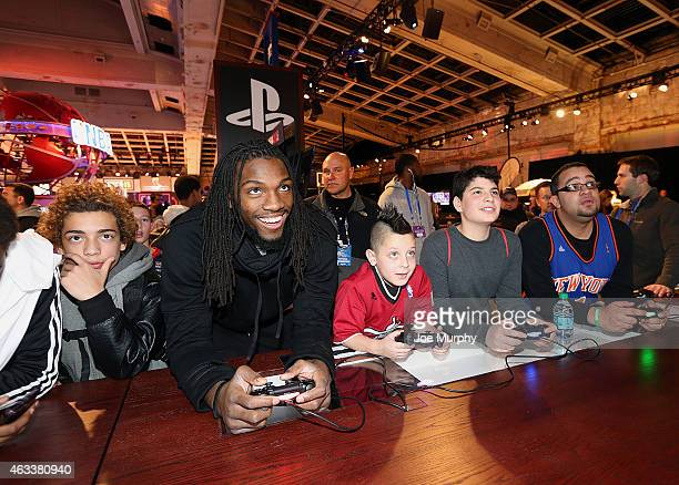 Kenneth Faried of the Denver Nuggets plays NBA2k15 with fans at the Playstation area at NBA House at Moynihan Station during the 2015 NBA AllStar on...