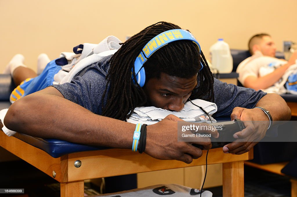 Kenneth Faried #35 of the Denver Nuggets plays with phone before the game against the Atlanta Hawks on March 4, 2013 at the Pepsi Center in Denver, Colorado.
