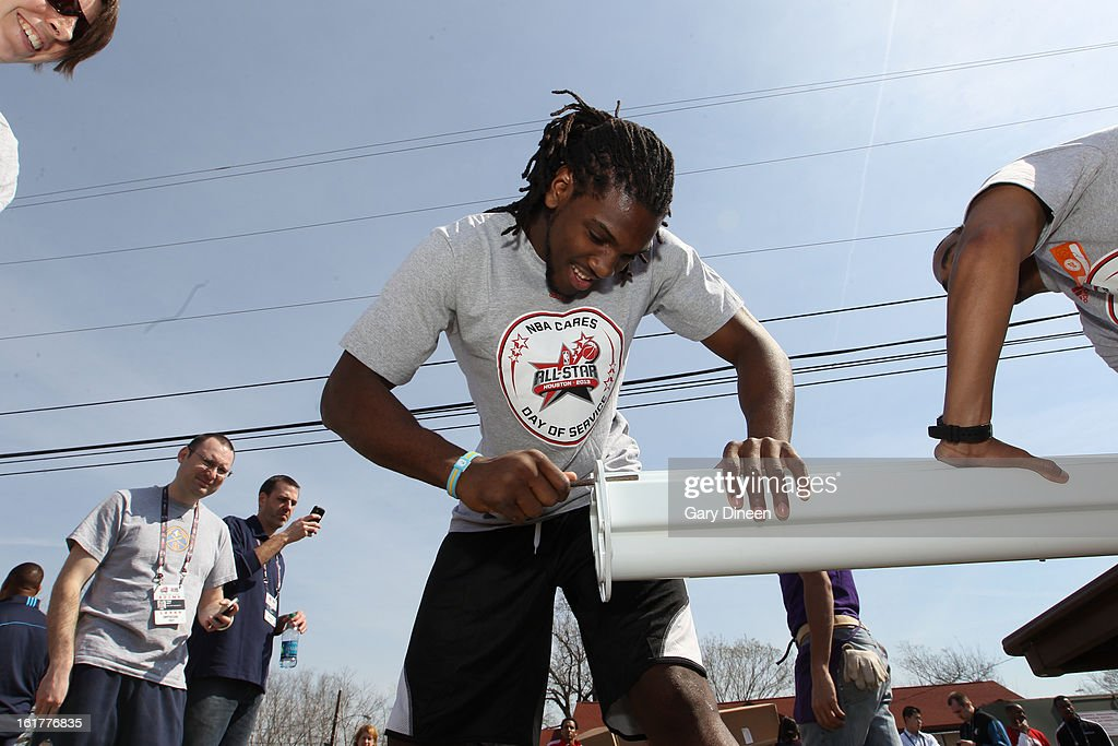 Kenneth Faried #35 of the Denver Nuggets puts together a playset at the 2013 NBA Cares Day of Service at the Playground Build with KaBOOM! on February 15, 2013 in Houston, Texas.
