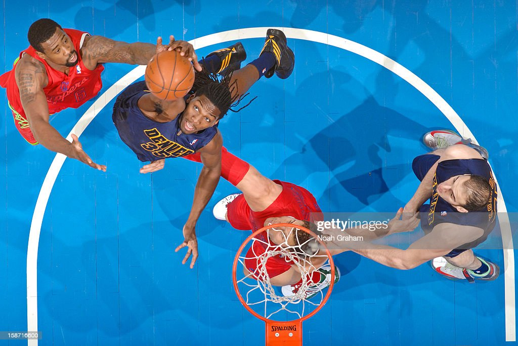<a gi-track='captionPersonalityLinkClicked' href=/galleries/search?phrase=Kenneth+Faried&family=editorial&specificpeople=5765135 ng-click='$event.stopPropagation()'>Kenneth Faried</a> #35 of the Denver Nuggets reaches for a rebound against <a gi-track='captionPersonalityLinkClicked' href=/galleries/search?phrase=DeAndre+Jordan&family=editorial&specificpeople=4665718 ng-click='$event.stopPropagation()'>DeAndre Jordan</a> #6 of the Los Angeles Clippers during a Christmas Day game at Staples Center on December 25, 2012 in Los Angeles, California.