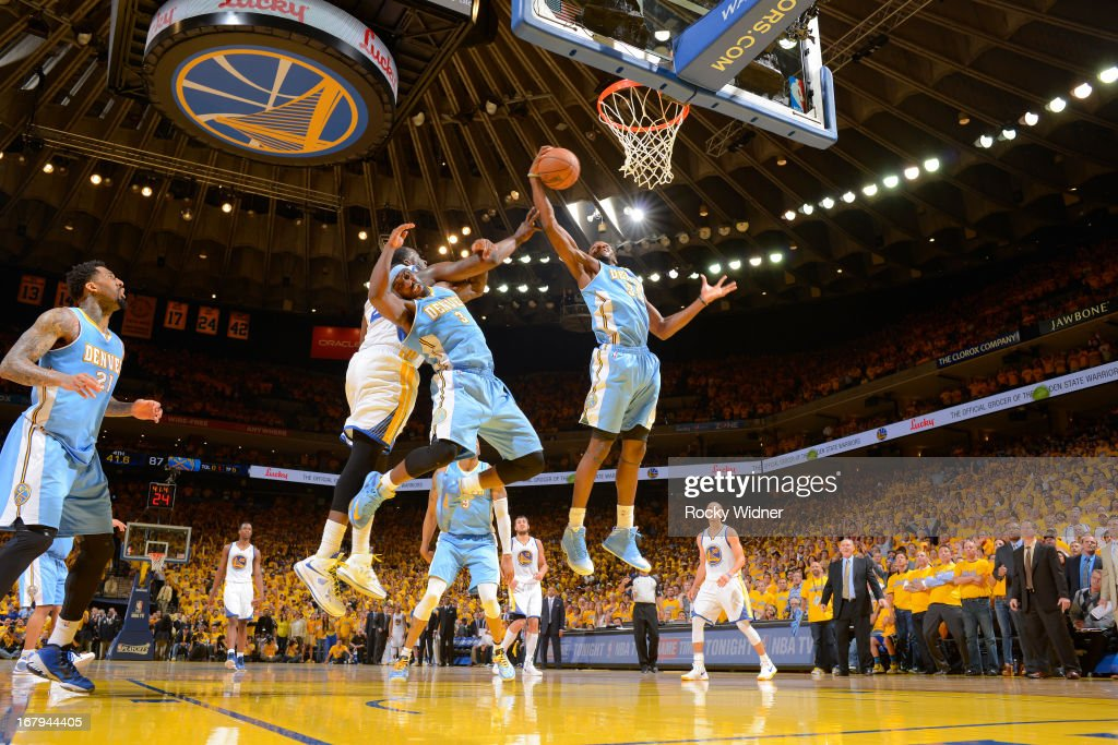 Kenneth Faried #35 of the Denver Nuggets rebounds against Draymond Green #23 of the Golden State Warriors in Game Six of the Western Conference Quarterfinals during the 2013 NBA Playoffs on May 2, 2013 at Oracle Arena in Oakland, California.