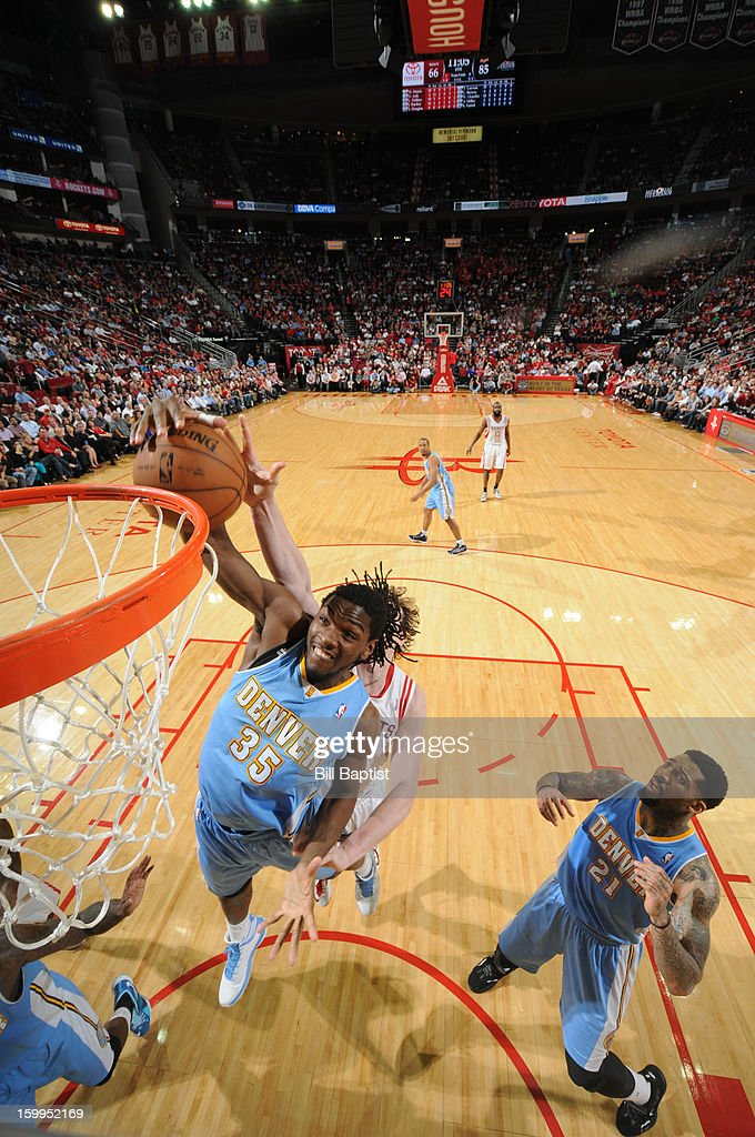 Kenneth Faried #35 of the Denver Nuggets rebounds the ball over Omer Asik #3 of the Houston Rockets on January 23, 2013 at the Toyota Center in Houston, Texas.