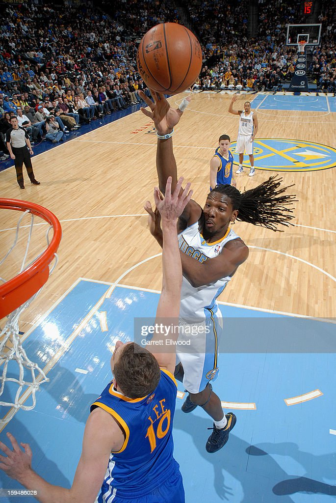 Kenneth Faried #35 of the Denver Nuggets shoots against David Lee #10 of the Golden State Warriors on January 13, 2013 at the Pepsi Center in Denver, Colorado.