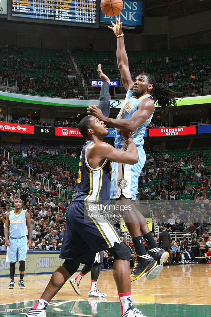 <a gi-track='captionPersonalityLinkClicked' href=/galleries/search?phrase=Kenneth+Faried&family=editorial&specificpeople=5765135 ng-click='$event.stopPropagation()'>Kenneth Faried</a> #35 of the Denver Nuggets shoots against <a gi-track='captionPersonalityLinkClicked' href=/galleries/search?phrase=Derrick+Favors&family=editorial&specificpeople=5792014 ng-click='$event.stopPropagation()'>Derrick Favors</a> #15 of the Utah Jazz at EnergySolutions Arena on November 11, 2013 in Salt Lake City, Utah.