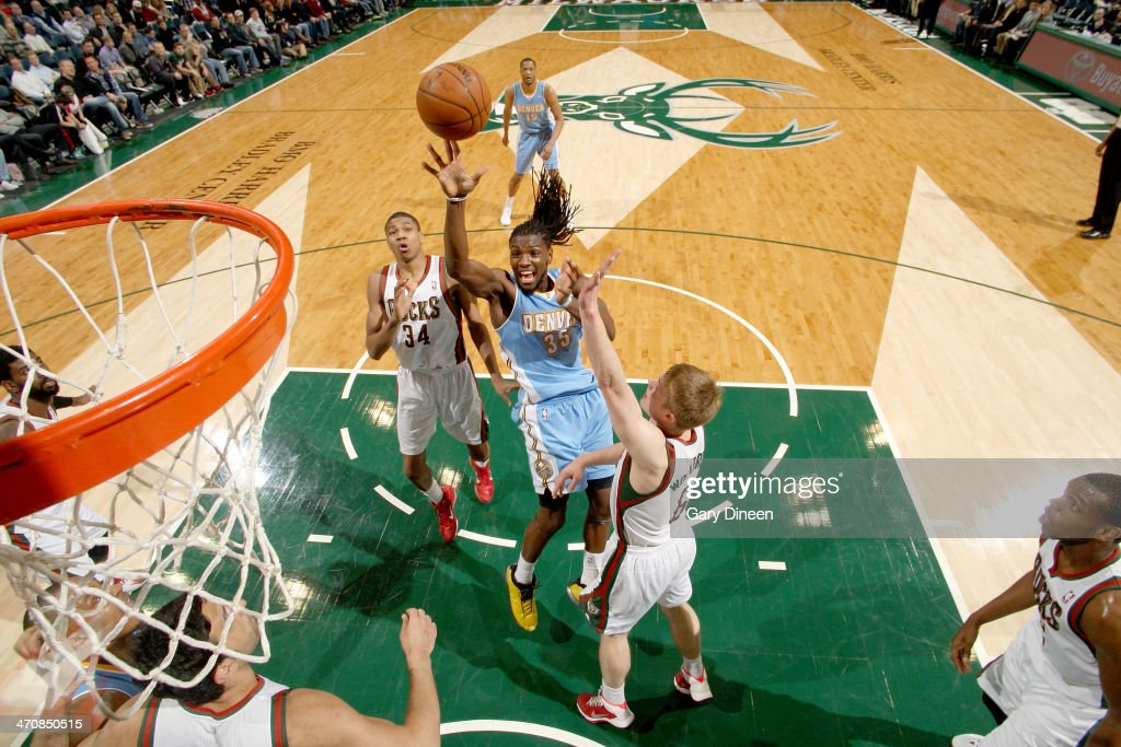 <a gi-track='captionPersonalityLinkClicked' href=/galleries/search?phrase=Kenneth+Faried&family=editorial&specificpeople=5765135 ng-click='$event.stopPropagation()'>Kenneth Faried</a> #35 of the Denver Nuggets shoots against (L-R) Giannis Antetokounmpo #34 and Nate Wolters #6 of the Milwaukee Bucks on February 20, 2014 at the BMO Harris Bradley Center in Milwaukee, Wisconsin.