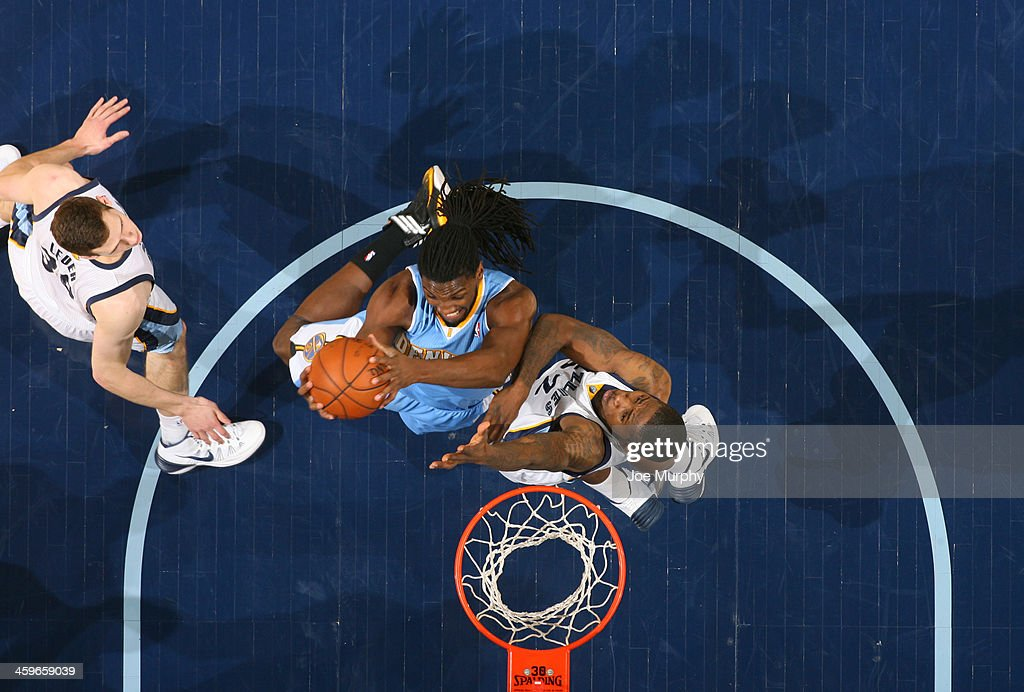 <a gi-track='captionPersonalityLinkClicked' href=/galleries/search?phrase=Kenneth+Faried&family=editorial&specificpeople=5765135 ng-click='$event.stopPropagation()'>Kenneth Faried</a> #35 of the Denver Nuggets shoots against the Memphis Grizzlies on December 28, 2013 at FedExForum in Memphis, Tennessee.