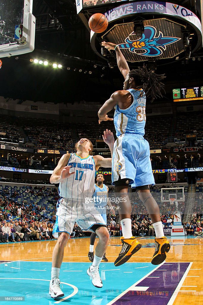 Kenneth Faried #35 of the Denver Nuggets shoots in the lane against Lou Amundson #17 of the New Orleans Hornets on March 25, 2013 at the New Orleans Arena in New Orleans, Louisiana.
