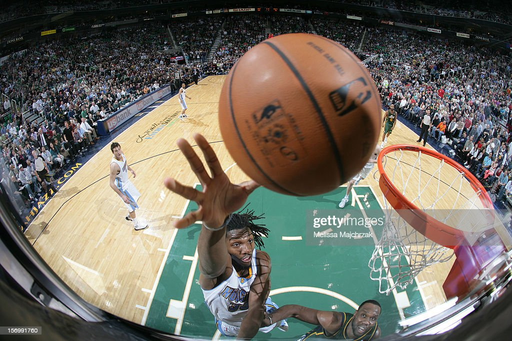 <a gi-track='captionPersonalityLinkClicked' href=/galleries/search?phrase=Kenneth+Faried&family=editorial&specificpeople=5765135 ng-click='$event.stopPropagation()'>Kenneth Faried</a> #35 of the Denver Nuggets shoots the layup against <a gi-track='captionPersonalityLinkClicked' href=/galleries/search?phrase=Al+Jefferson&family=editorial&specificpeople=201604 ng-click='$event.stopPropagation()'>Al Jefferson</a> #25 of the Utah Jazz at Energy Solutions Arena on November 26, 2012 in Salt Lake City, Utah.