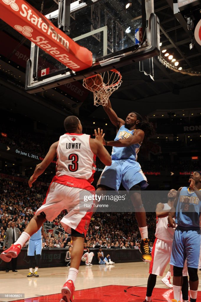 <a gi-track='captionPersonalityLinkClicked' href=/galleries/search?phrase=Kenneth+Faried&family=editorial&specificpeople=5765135 ng-click='$event.stopPropagation()'>Kenneth Faried</a> #35 of the Denver Nuggets slamdunks the ball against <a gi-track='captionPersonalityLinkClicked' href=/galleries/search?phrase=Kyle+Lowry&family=editorial&specificpeople=714625 ng-click='$event.stopPropagation()'>Kyle Lowry</a> #3 of the Toronto Raptors during the game on February 12, 2013 at the Air Canada Centre in Toronto, Ontario, Canada.