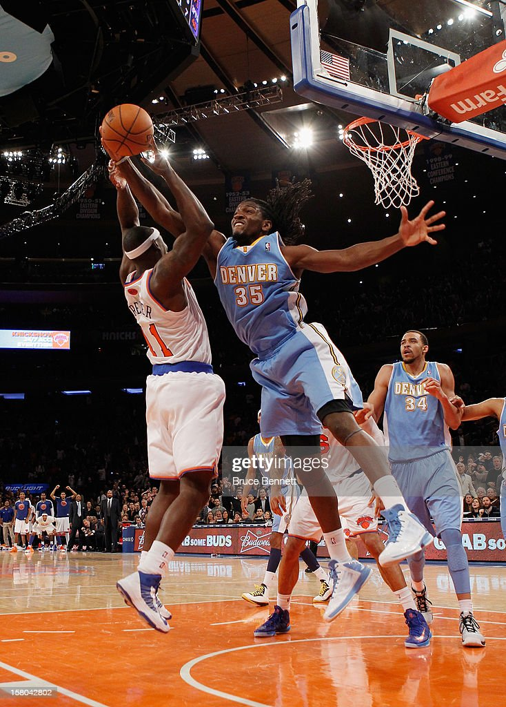 Kenneth Faried #35 of the Denver Nuggets stops a shot by Ronnie Brewer #11 of the New York Knicks at Madison Square Garden on December 9, 2012 in New York City.