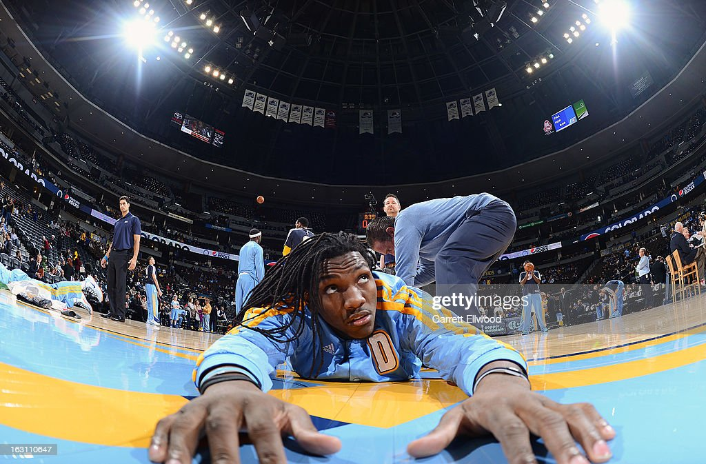 Kenneth Faried #35 of the Denver Nuggets stretches with a trainer before a game against the Atlanta Hawks on March 4, 2013 at the Pepsi Center in Denver, Colorado.