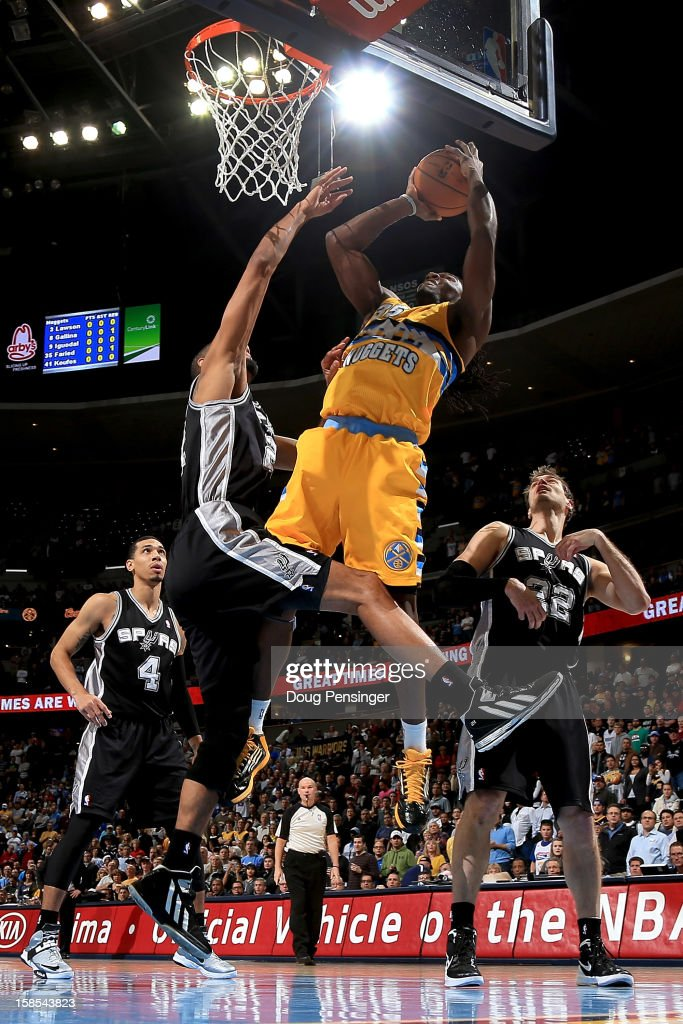 <a gi-track='captionPersonalityLinkClicked' href=/galleries/search?phrase=Kenneth+Faried&family=editorial&specificpeople=5765135 ng-click='$event.stopPropagation()'>Kenneth Faried</a> #35 of the Denver Nuggets takes a shot against <a gi-track='captionPersonalityLinkClicked' href=/galleries/search?phrase=Tim+Duncan&family=editorial&specificpeople=201467 ng-click='$event.stopPropagation()'>Tim Duncan</a> #21 of the San Antonio Spurs at the Pepsi Center on December 18, 2012 in Denver, Colorado.