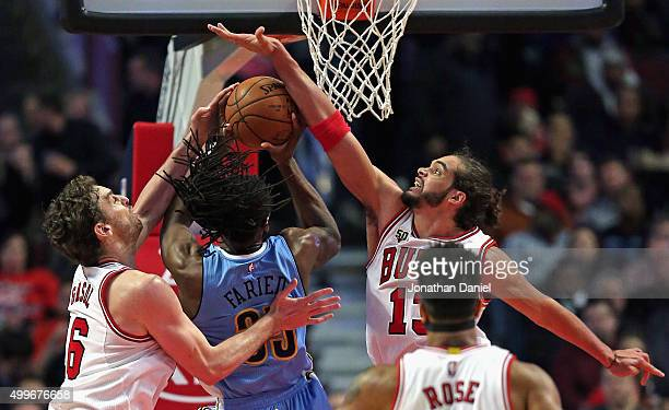 Kenneth Faried of the Denver Nuggets tries to get off a shot between Pau Gasol and Joakim Noah of the Chicago Bulls at the United Center on December...