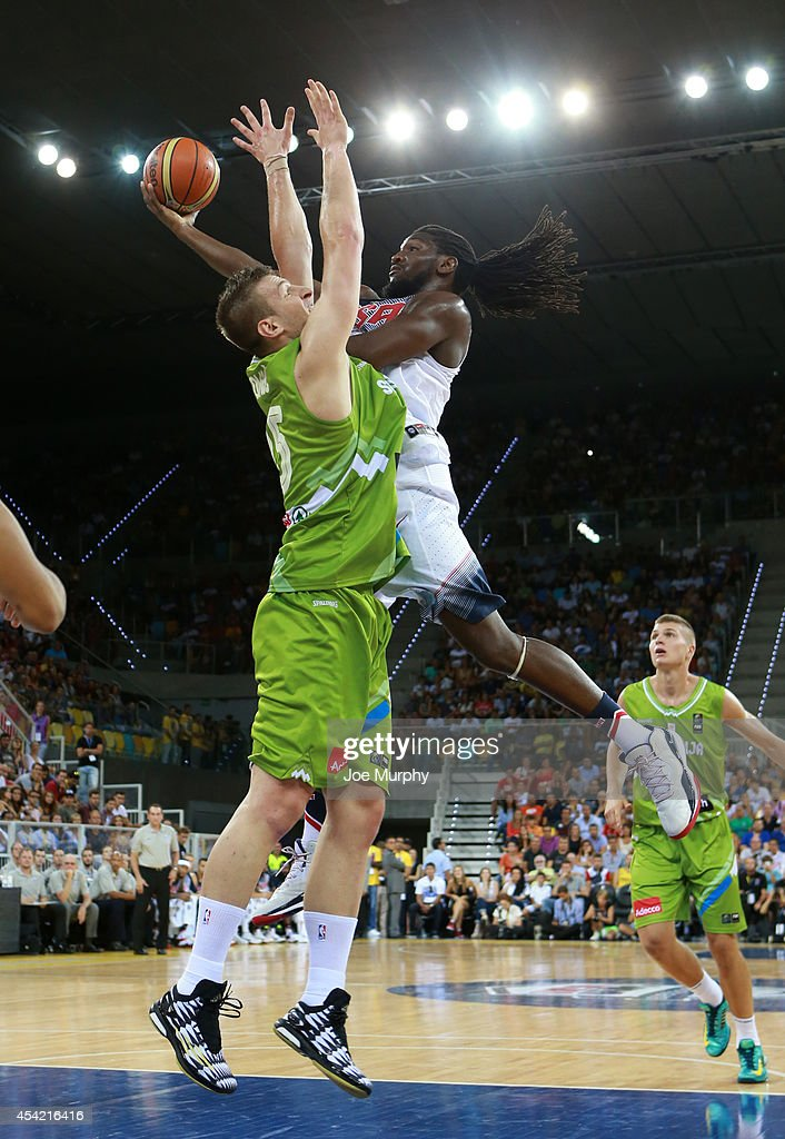 <a gi-track='captionPersonalityLinkClicked' href=/galleries/search?phrase=Kenneth+Faried&family=editorial&specificpeople=5765135 ng-click='$event.stopPropagation()'>Kenneth Faried</a> #18 of the USA Basketball Men's National Team drives to the basket against the Slovenia Basketball Men's National Team on August 26, 2014 at Gran Canaria Arena in Las Palmas, Gran Canaria, Spain.