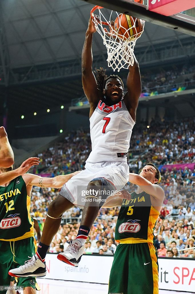 <a gi-track='captionPersonalityLinkClicked' href=/galleries/search?phrase=Kenneth+Faried&family=editorial&specificpeople=5765135 ng-click='$event.stopPropagation()'>Kenneth Faried</a> #7 of the USA Basketball Men's National Team dunks the ball against Lithuania Basketball Men's National Team during a 2014 FIBA Basketball World Cup semi-final match between USA and Lithuania at Palau Sant Jordi on September 11, 2014 in Barcelona, Spain.