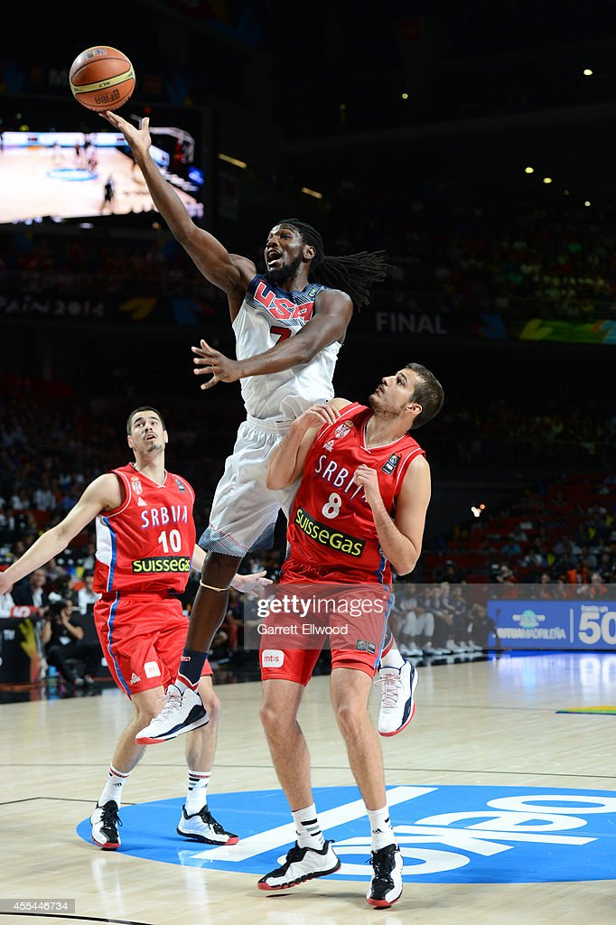 <a gi-track='captionPersonalityLinkClicked' href=/galleries/search?phrase=Kenneth+Faried&family=editorial&specificpeople=5765135 ng-click='$event.stopPropagation()'>Kenneth Faried</a> #7 of the USA Men's National Team shoots against <a gi-track='captionPersonalityLinkClicked' href=/galleries/search?phrase=Nemanja+Bjelica&family=editorial&specificpeople=5625698 ng-click='$event.stopPropagation()'>Nemanja Bjelica</a> #8 of the Serbia National Team during the 2014 FIBA World Cup Finals at Palacio de Deportes on September 14, 2014 in Madrid, Spain.