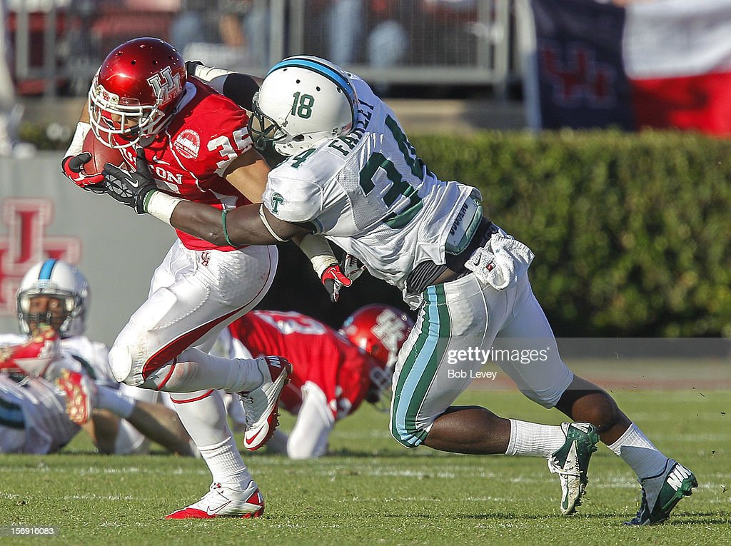 Kenneth Farrow #35 of the Houston Cougars is brought down by Darryl Farley #34 of the Tulane Green Wave at Robertson Stadium on November 24, 2012 in Houston, Texas. Houston defeats Tulane 40-17.