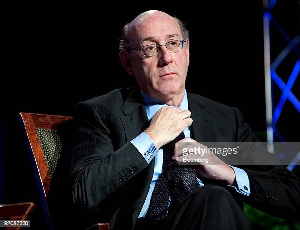 Kenneth Feinberg the US Treasury Department's special master for compensation straightens his tie during a panel discussion at the National...