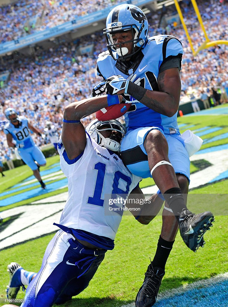 Kenneth Gilstrap #18 of the Middle Tennessee State Blue Raiders breaks up a pass in the end zone intended for Quinshad Davis #14 of the North Carolina Tar Heels during play at Kenan Stadium on September 7, 2013 in Chapel Hill, North Carolina.