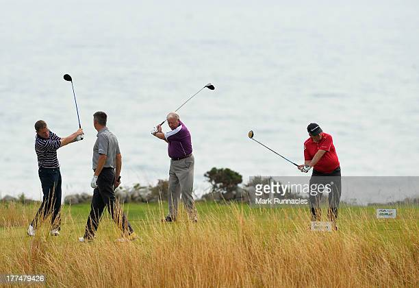 Kenneth Hutton and Jack Clinton of Downfield Golf Club with Sandy Smith and Bill Brooksbank of Ladybank Golf Club keeping warm on the 14th tee during...