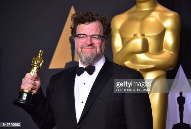 TOPSHOT Kenneth Lonergan poses in the press room with the Oscar for Best Original Screenplay during the 89th Annual Academy Awards on February 26 in...
