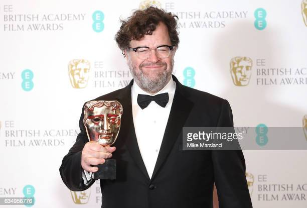 Kenneth Lonergan winner of the Original Screenplay award for 'Manchester By The Sea' poses in the winners room at the 70th EE British Academy Film...
