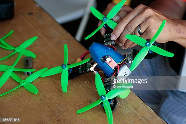 Kenneth Loo puts the finishing touches on his drone during practice day at the National Drone Racing Championships on Governors Island August 5 2016...