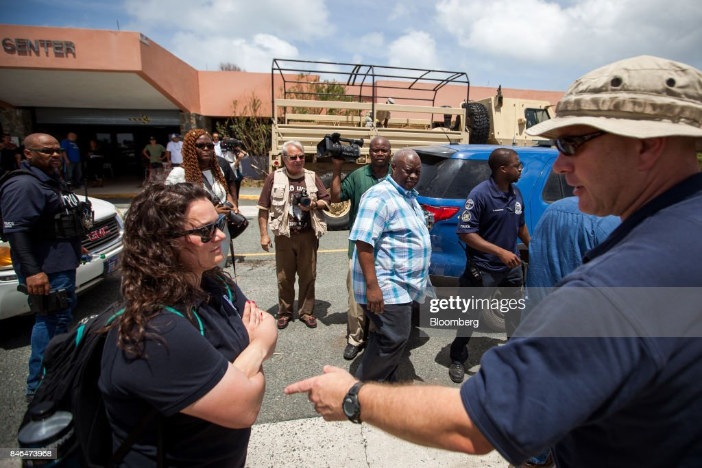 Kenneth Mapp, governor of the U.S. Virgin Islands, center, accesses the damage after Hurricane Irma in St John, U.S. Virgin Islands, on Tuesday, Sept. 12, 2017. After being struck by Irma last week, the U.S. Virgin Islands couldnt look less like a tourist destination. Many local residents are giving up and getting out after losing everything to the category 5 storm,even as the local authorities in the U.S. territory say they are determined to rebuild the islands. Photographer: Michael Nagle/Bloomberg via Getty Images