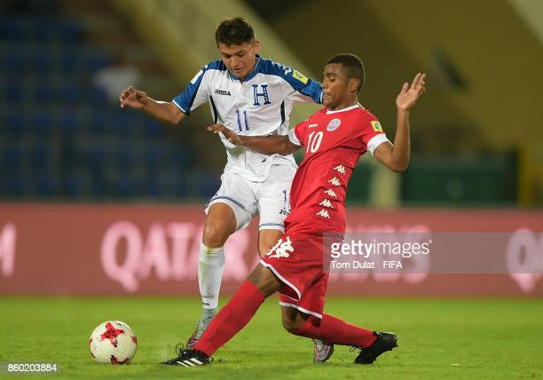 Kenneth Martinez of Honduras and Cyril Nyipie of New Caledonia in action during the FIFA U17 World Cup India 2017 group E match between Honduras and...