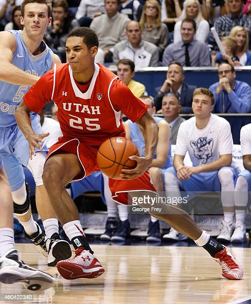 Kenneth Ogbe of the Utah Utes drives the ball against the Brigham Young Cougars during the first half of an college basketball game December 10 2014...