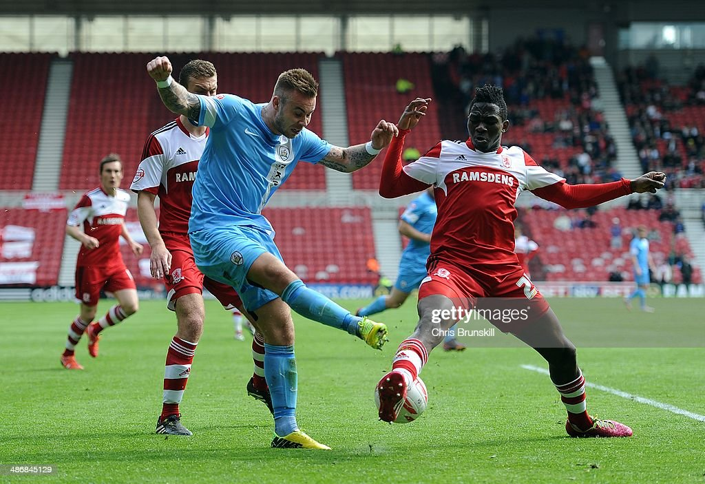 <a gi-track='captionPersonalityLinkClicked' href=/galleries/search?phrase=Kenneth+Omeruo&family=editorial&specificpeople=6392838 ng-click='$event.stopPropagation()'>Kenneth Omeruo</a> of Middlesbrough challenges Marcus Pederson of Barnsley during the Sky Bet Championship match between Middlesbrough and Barnsley at the Riverside Stadium on April 26, 2014 in Middlesbrough, England.