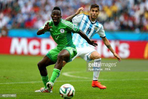 Kenneth Omeruo of Nigeria and Ricardo Alvarez of Argentina compete for the ball during the 2014 FIFA World Cup Brazil Group F match between Nigeria...