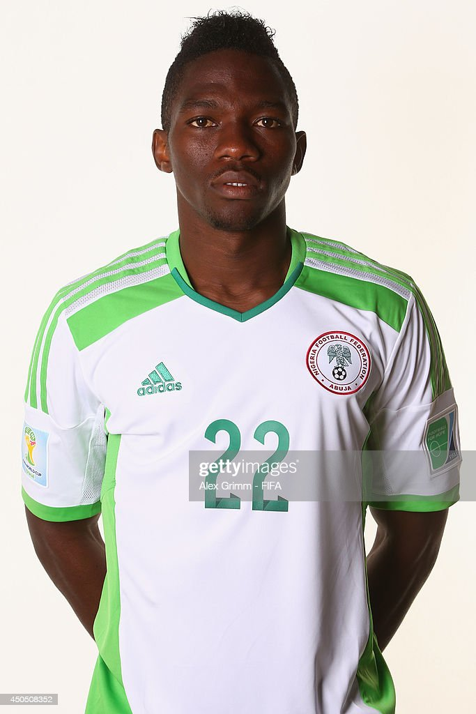 <a gi-track='captionPersonalityLinkClicked' href=/galleries/search?phrase=Kenneth+Omeruo&family=editorial&specificpeople=6392838 ng-click='$event.stopPropagation()'>Kenneth Omeruo</a> of Nigeria poses during the official FIFA World Cup 2014 portrait session on June 12, 2014 in Campinas, Brazil.