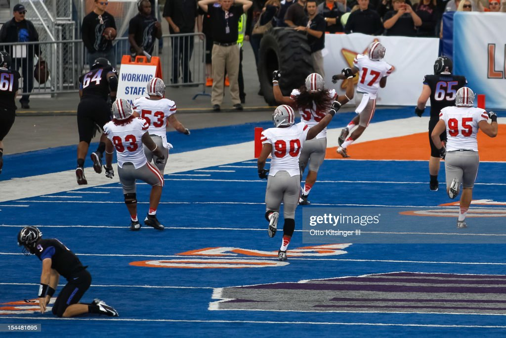 Kenneth Penny #17 of the UNLV Rebels recovers a fumble by Grant Hedrick #9 of the Boise State Broncos and returns it for a touchdown at Bronco Stadium on October 20, 2012 in Boise, Idaho.